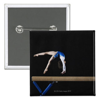 Gymnast (9-10) flipping on balance beam, side 15 cm square badge