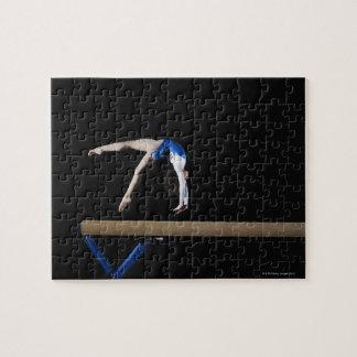 Gymnast (9-10) flipping on balance beam, side jigsaw puzzle