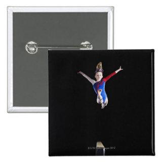 Gymnast (9-10) leaping on balance beam 15 cm square badge