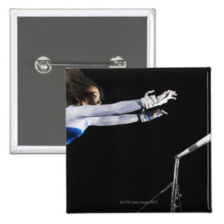 Gymnast (9-10) reaching for uneven bars 2 15 cm square badge