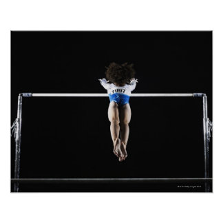Gymnast (9-10) reaching for uneven bars poster