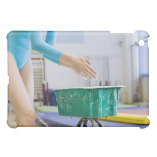 Gymnast chalking her hands case for the iPad mini