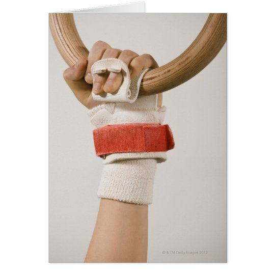 Gymnast hand holding ring card