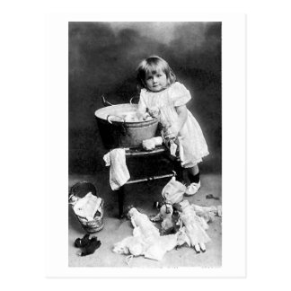 h304 Edwardian Girl with Dolls Clothes Postcard
