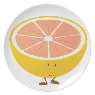 Half grapefruit smiling character plate