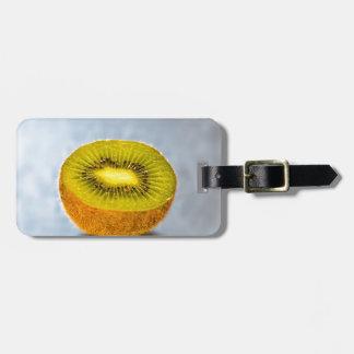 half Kiwi on the table Luggage Tag