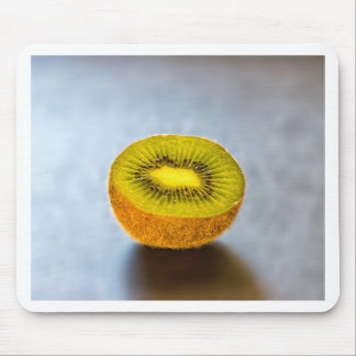 half Kiwi on the table Mouse Pad