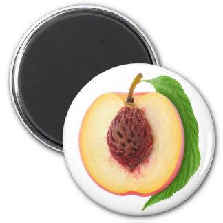 Half of peach 6 cm round magnet