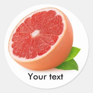 Half of pink grapefruit round sticker