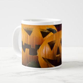 Halloween Background With Pumpkins In The Grass Jumbo Mug