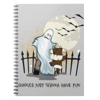 Halloween cartoon ghost in cemetery notebooks