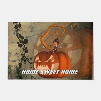 Halloween, funny pumpkin with cute witch doormat