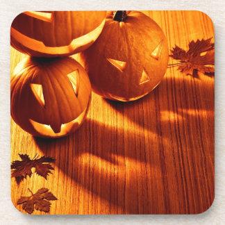 Halloween glowing pumpkins border beverage coasters