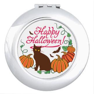 Halloween greetings with black cat makeup mirror