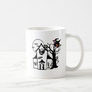 Halloween haunted house and witch coffee mug