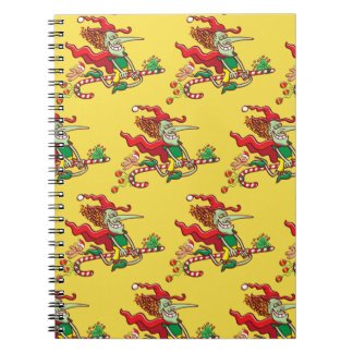 Halloween witch flying on a Christmas candy cane Notebook