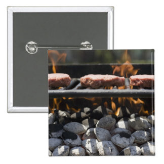 Hamburgers cooking on grill 15 cm square badge