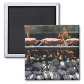 Hamburgers cooking on grill magnet