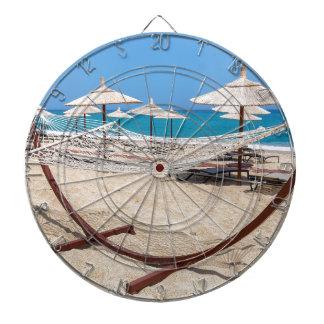 Hammock with beach umbrellas at coast dartboard