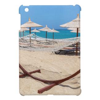 Hammock with beach umbrellas at coast iPad mini cover