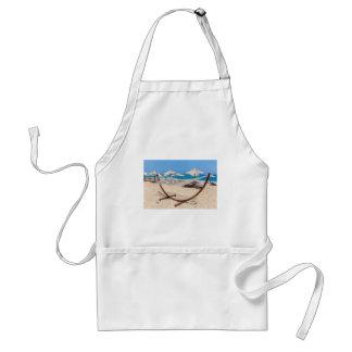 Hammock with beach umbrellas at coast standard apron