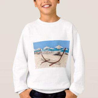 Hammock with beach umbrellas at coast sweatshirt