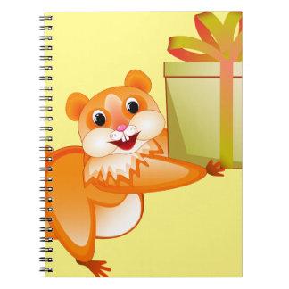 Hamster keeps the gift spiral notebook