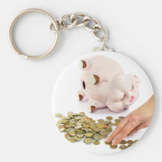 Hand counting euro coins from piggy bank basic round button key ring