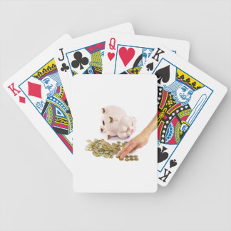 Hand counting euro coins from piggy bank bicycle playing cards