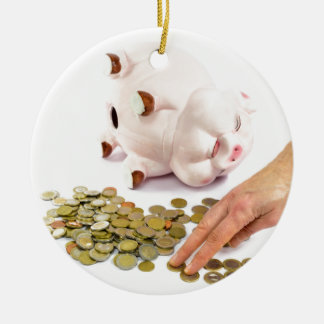 Hand counting euro coins from piggy bank ceramic ornament