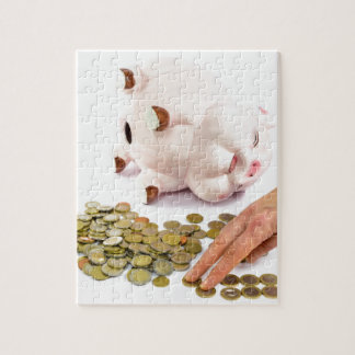 Hand counting euro coins from piggy bank jigsaw puzzle