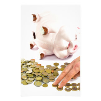 Hand counting euro coins from piggy bank stationery