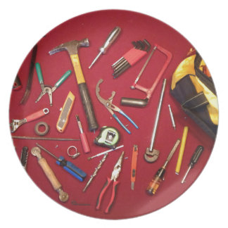 Hand held tools and tool bag red background plate