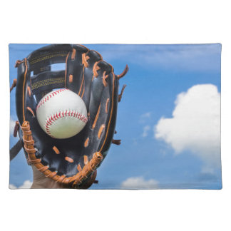 Hand holding baseball in glove with blue sky placemat