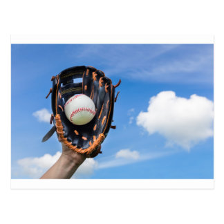 Hand holding baseball in glove with blue sky postcard