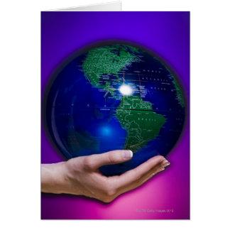 Hand holding earth card
