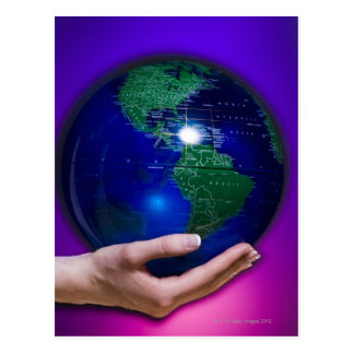 Hand holding earth postcard