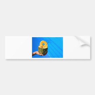 Hand holding fresh pineapple above swimming pool bumper sticker