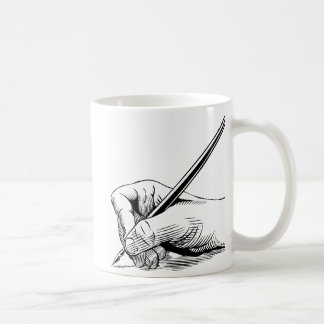 Hand holding pen coffee mug