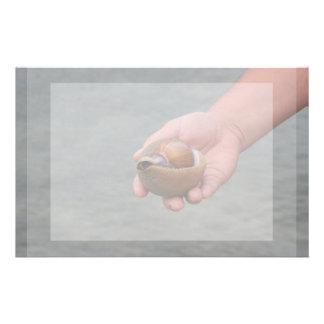 hand holding seashell ocean shore image customised stationery
