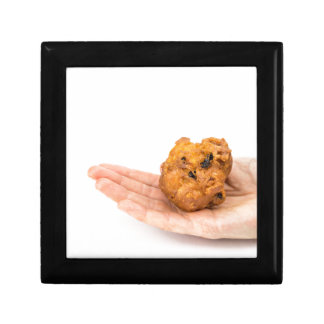 Hand palm showing fritter or oliebol gift box