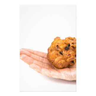 Hand palm showing fritter or oliebol stationery