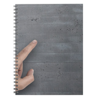 Hand showing concept on copy space template spiral notebook