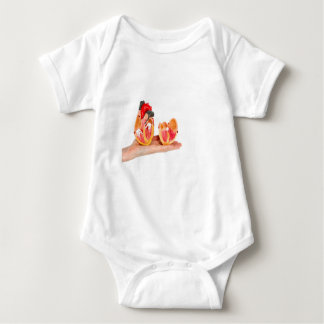 Hand with human heart model on white background.jp baby bodysuit
