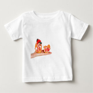Hand with human heart model on white background.jp baby T-Shirt