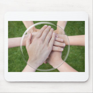 Hands arms uniting in glass sphere mouse pad