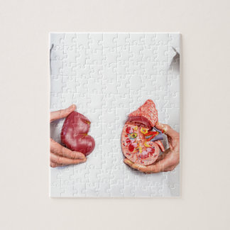 Hands holding model of human kidney organ at body. jigsaw puzzle