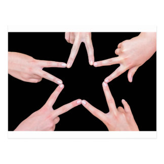 Hands of girls making star shape on black postcard