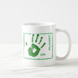 Hands on planet mug