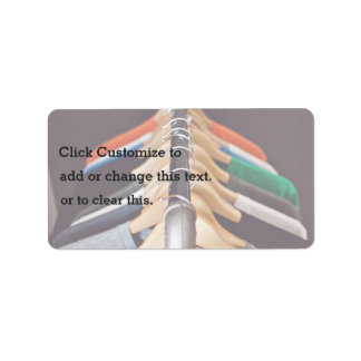 Hanger Themed, Shirts Of Various Colors On Wooden Address Label